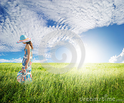 Alone Woman with blue sky in green fields