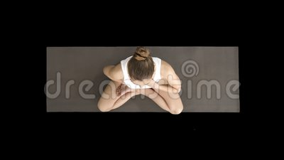 yoga girl breathing in lotus pose with her hands on her