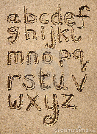 The alphabet written in sand.