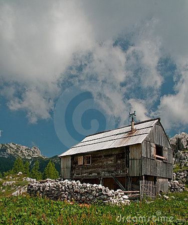 Alpine cottage in the mountains