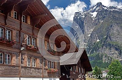 Alpine house, mountains and sky