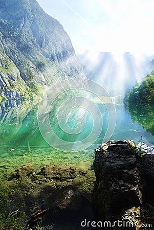 Alpine lake with sun rays