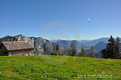 Alpine landscape and a paraglider