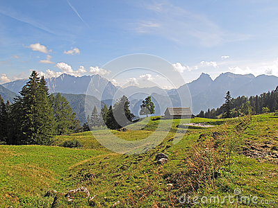 Alpine panorama scene with hut