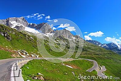 Alpine road through mountain landscape