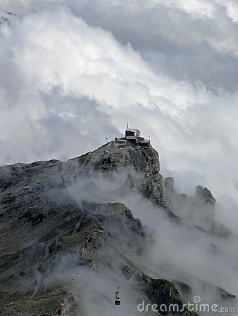 Alps with mist and cable car