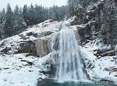 Alps waterfall winter view