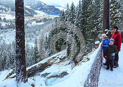 Alps waterfall winter view and family