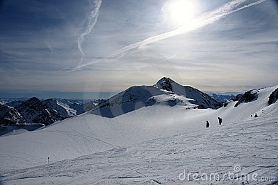 Alps winter view with skiers