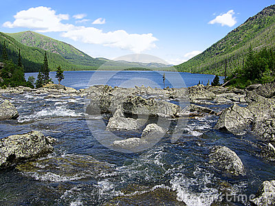 Altai Mountains. River Shumy and lake Multinskoye