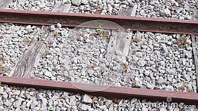 Alte Eisenbahn mit Steinen stock footage