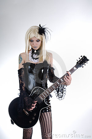 Alternative fashion girl playing guitar