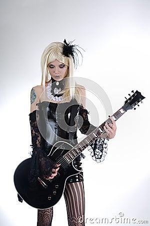 Alternative fashion girl playing guitar