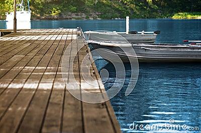 Aluminum Fishing Boats at Wood Dock