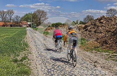 Amateur Cyclists on a Cobblestone Road Editorial Photography