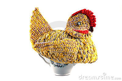 Amateur knitted hen on a tea brewing teapot