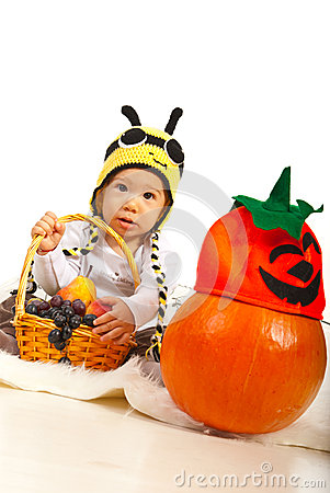 Amazed baby in bee hat