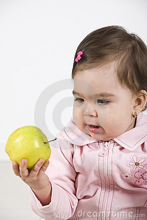 Amazed baby of a green apple