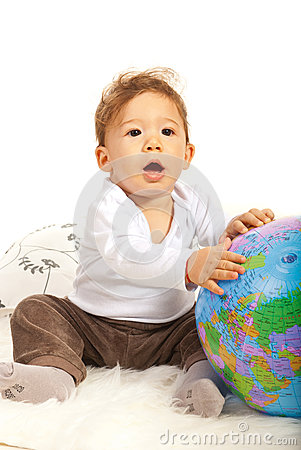 Amazed baby with world globe