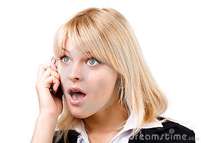 Amazed blonde girl talking on phone