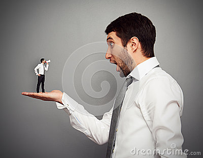 Amazed boss with small man