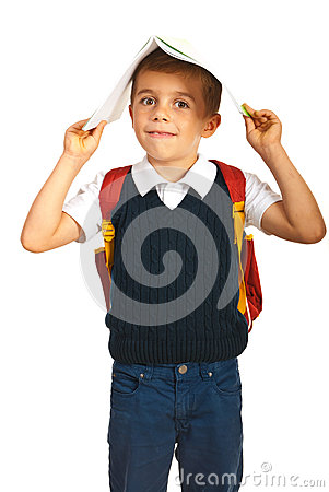 Amazed boy with notebook on head