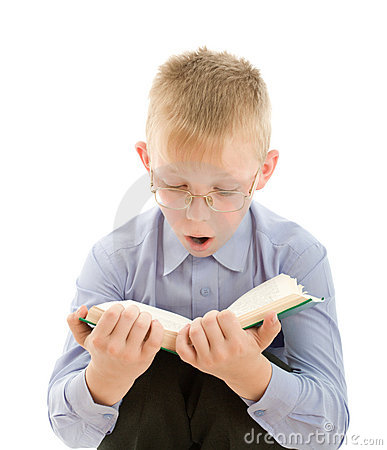Amazed boy reading very interesting book