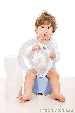 Amazed boy sitting on potty