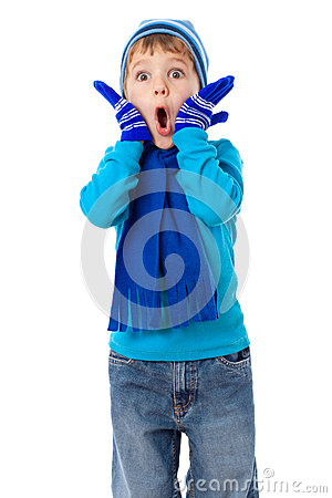 Amazed boy in winter clothes