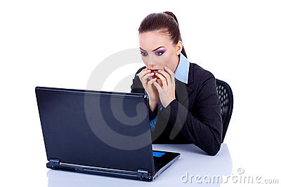 Amazed business woman at her laptop
