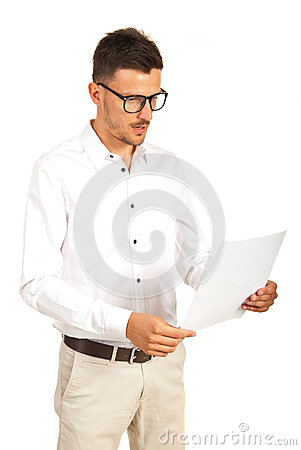 Amazed businessman looking to paper