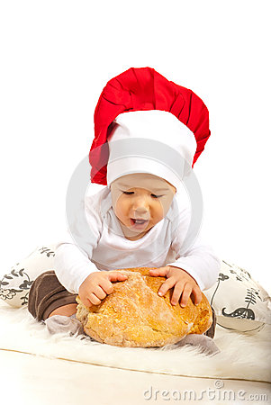 Amazed chef baby with bread