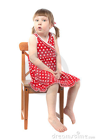 Amazed child sitting on a chair