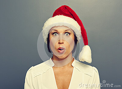 Amazed christmas woman in red hat