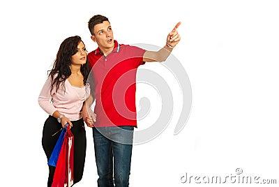 Amazed couple looking away