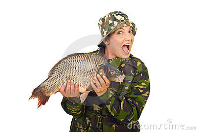 Amazed fisher woman holding big carp