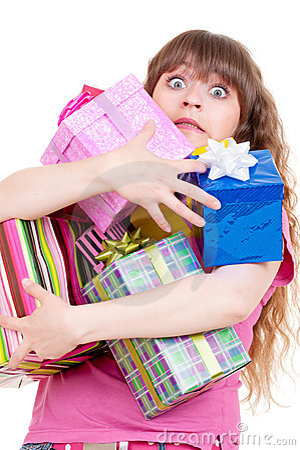 Amazed girl with gifts