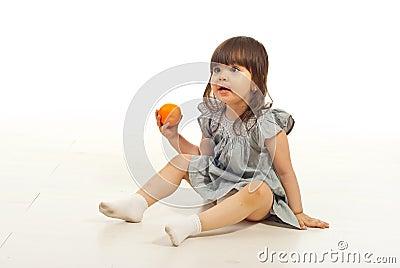 Amazed girl holding mandarin