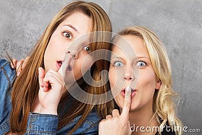 Amazed girls hushing - shh