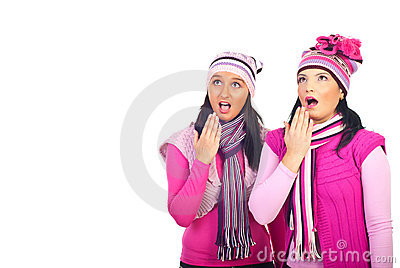 Amazed girls in pink woolen clothes
