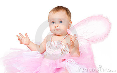 Amazed infant girl in fairy attire isolated