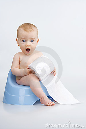 Amazed infant on potty.