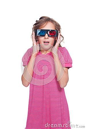 Amazed little girl in 3d glasses