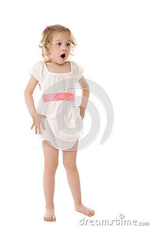 Amazed little girl standing on white background