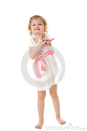 Amazed little girl wearing a white dress