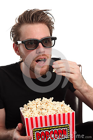 Amazed man in 3D-glasses with a popcorn bucket
