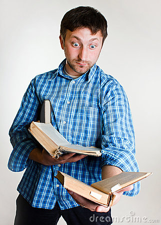 Amazed man with books in hand