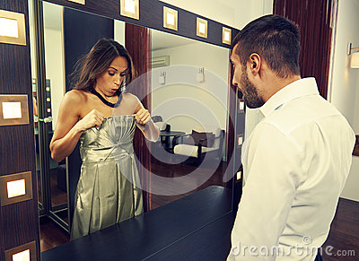 Amazed man looking at woman