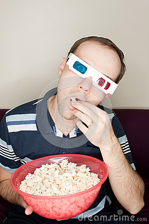 Amazed man watching a movie