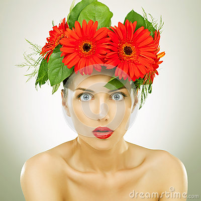 Amazed  with red gerbera flowers on her head